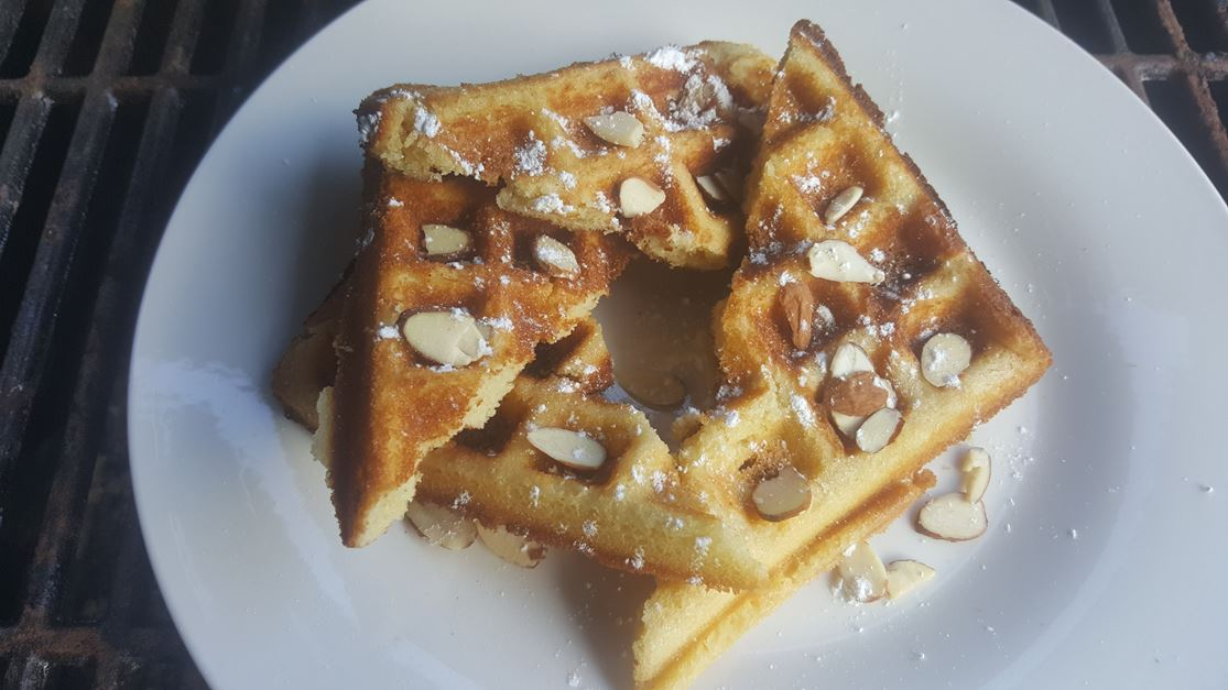 Classic waffles topped with slivered almonds and amaretto syrup