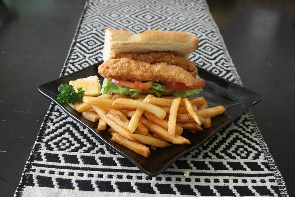"Freshly fried catfish stacked on fresh French bread. Served ""dressed"" with lettuce, tomato, and pickles with a choice of regular or chipotle mayonnaise. 6 inch version."