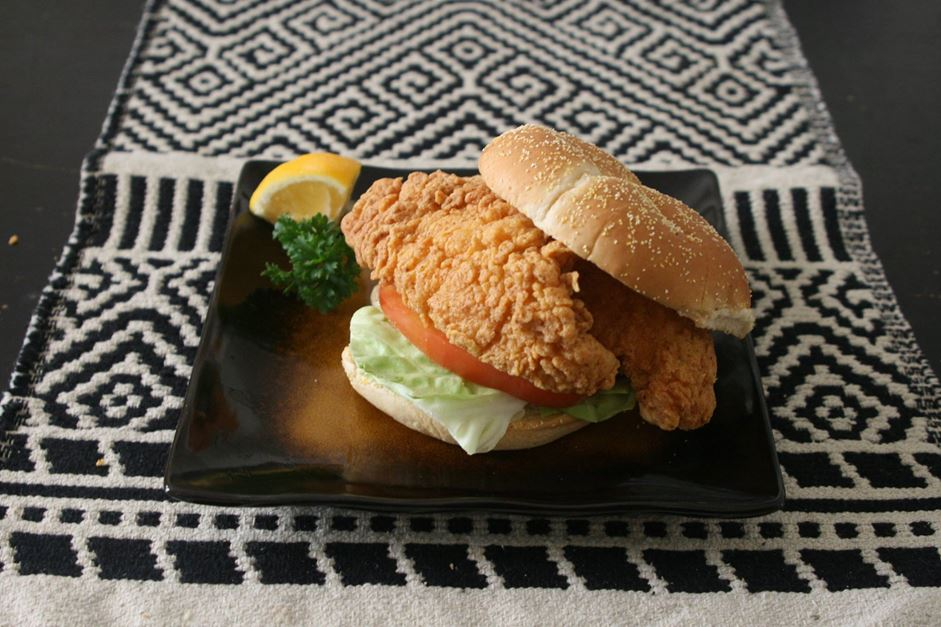 "Freshly fried catfish stacked on a bun. Served ""dressed"" with lettuce, tomato, and pickles with a choice of regular or chipotle mayonnaise."