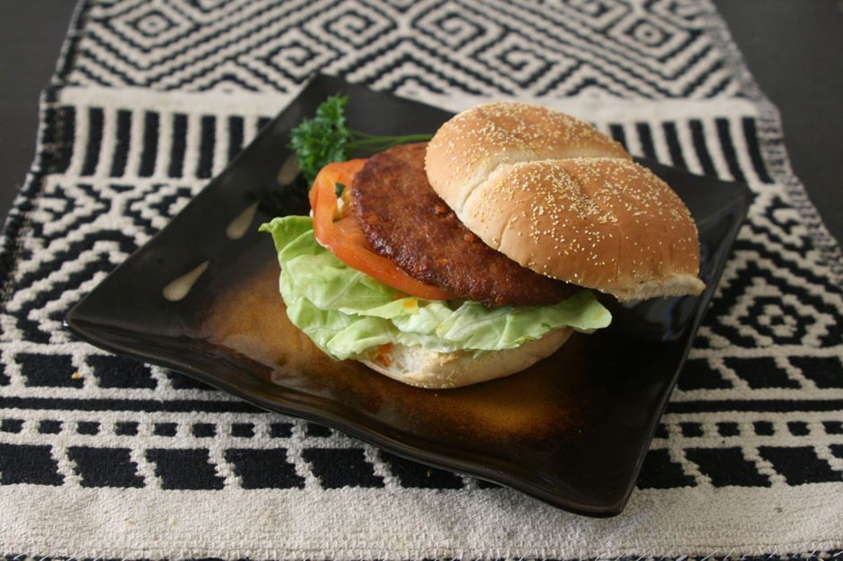 "New Orleans-style hot sausage patties fried crisp and served on a bun  ""dressed"" with lettuce, tomato, and pickles with a choice of regular or chipotle mayonnaise."