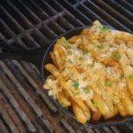 Crispy French fries smothered in our signature crawfish queso sauce.