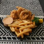 Crispy, seasoned, fried jumbo shrimp served with fresh French fries.