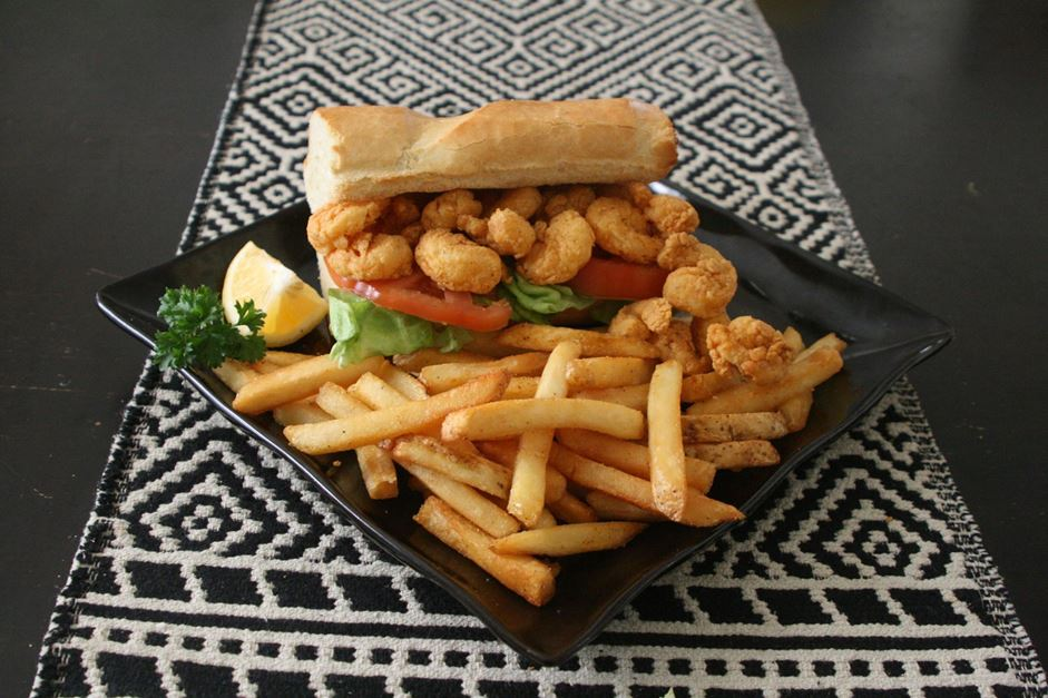 "Crispy fried shrimp piled on a 6 inch fresh French Served ""dressed"" with lettuce, tomato, and pickles with a choice of regular or chipotle mayonnaise."