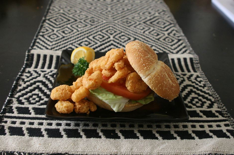 "Crispy fried shrimp piled on a bun Served ""dressed"" with lettuce, tomato, and pickles with a choice of regular or chipotle mayonnaise."